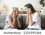 happy senior mother and adult... | Shutterstock . vector #1231591366