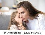 loving mother listens to child... | Shutterstock . vector #1231591483