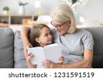 loving grandmother teaching... | Shutterstock . vector #1231591519