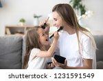 smiling mom and kid preschool... | Shutterstock . vector #1231591549