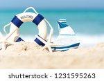 Lifebuoy On Sand Beach...