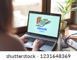 laptop screen displaying an e... | Shutterstock . vector #1231648369