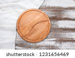 table cloth and pizza board on... | Shutterstock . vector #1231656469