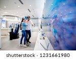 man pointing on tv he like.... | Shutterstock . vector #1231661980