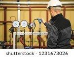 technician engineer checking... | Shutterstock . vector #1231673026