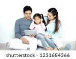 asian family are listening to... | Shutterstock . vector #1231684366
