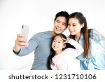 asian family selfie on white... | Shutterstock . vector #1231710106