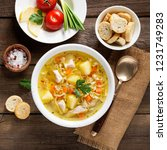 chicken soup with noodles and... | Shutterstock . vector #1231749283