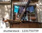 drying laundry on small balcony ... | Shutterstock . vector #1231753759