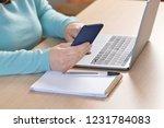 close up of a woman hands using ... | Shutterstock . vector #1231784083