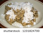 tiwul rice with grated coconut. ... | Shutterstock . vector #1231824700