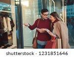 beautiful young couple enjoying ... | Shutterstock . vector #1231851646