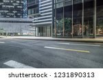 empty road with modern... | Shutterstock . vector #1231890313