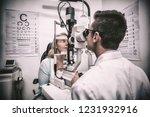 attentive optometrist examining ... | Shutterstock . vector #1231932916