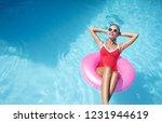 enjoying suntan and vacation.... | Shutterstock . vector #1231944619
