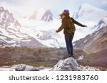 girl stands on big rock and... | Shutterstock . vector #1231983760