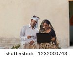 rural couple using laptop and...   Shutterstock . vector #1232000743