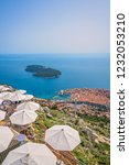 umbrellas providing shadow for... | Shutterstock . vector #1232053210