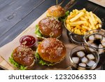 four sandwiches fast food on a... | Shutterstock . vector #1232066353