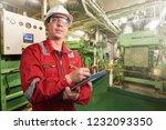 ship's mechanic near marine... | Shutterstock . vector #1232093350