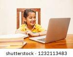 little girl studying online... | Shutterstock . vector #1232113483