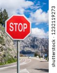 red stop sign on the road in... | Shutterstock . vector #1232119273