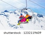 family in ski lift in swiss... | Shutterstock . vector #1232119609