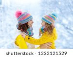 mother and child in knitted... | Shutterstock . vector #1232121529