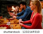 happy parents playing cards... | Shutterstock . vector #1232169310
