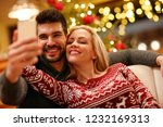 happy couple in warm sweaters... | Shutterstock . vector #1232169313
