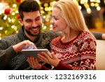 couple in warm sweaters... | Shutterstock . vector #1232169316