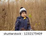 boy was lost in the forest.... | Shutterstock . vector #1232175409