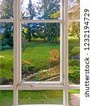 beautiful garden seen through... | Shutterstock . vector #1232194729