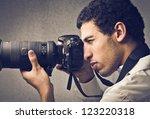mulatto man using a... | Shutterstock . vector #123220318
