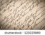 Small photo of vintage ink handwriting. grungy paper background