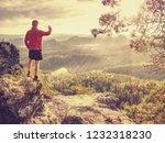 hiker is taking photo by smart... | Shutterstock . vector #1232318230
