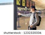 passenger looking at departures ... | Shutterstock . vector #1232320336