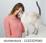 portrait of a young brunette... | Shutterstock . vector #1232329360