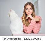 portrait of a young brunette... | Shutterstock . vector #1232329363