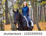 teenage girl riding horse in... | Shutterstock . vector #1232350933
