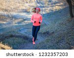 young slim girl running in the... | Shutterstock . vector #1232357203