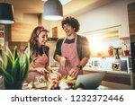 young happy couple is enjoying... | Shutterstock . vector #1232372446