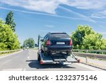 car carrier trailer with car.... | Shutterstock . vector #1232375146