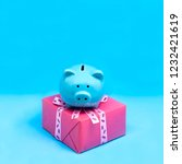 piggy bank with gift for...   Shutterstock . vector #1232421619