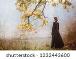 Woman In A Long Black Coat Over ...