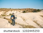 a tourist with a backpack...   Shutterstock . vector #1232445253