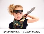 toddler girl with an army knife | Shutterstock . vector #1232450209