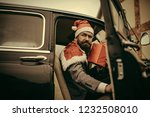 hipster in red hat deliver xmas ... | Shutterstock . vector #1232508010