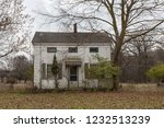 abandoned house with bare trees ... | Shutterstock . vector #1232513239