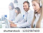 call center worker accompanied... | Shutterstock . vector #1232587603